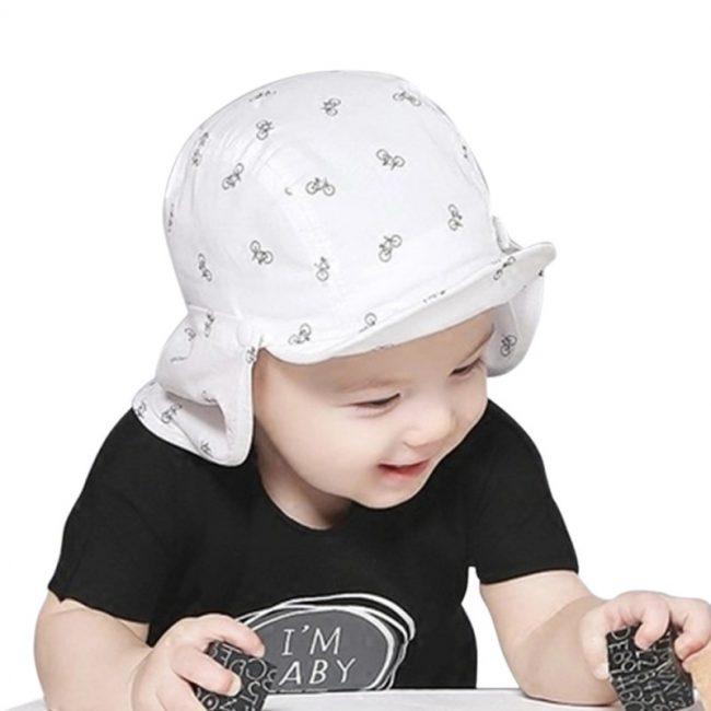 Stoere baby pet wit met zonnedoek 1-2 jaar