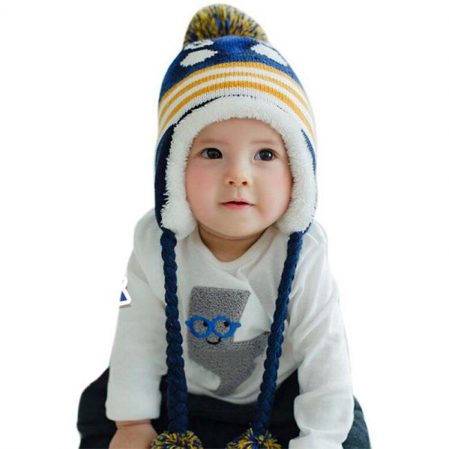 wintermuts baby met voering puinguin blauw